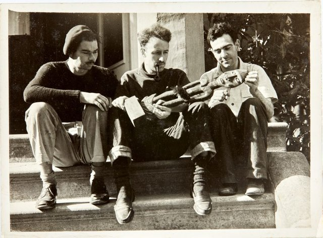 An image of Robert Klippel and friends with a carving from William Ohly's collection at the Abbey Art Centre in London