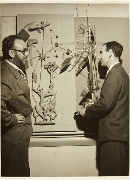 An image of Robert Klippel and Tom Bass with their works at the third exhibition of the Society of Sculptors and Associates in 1953 by