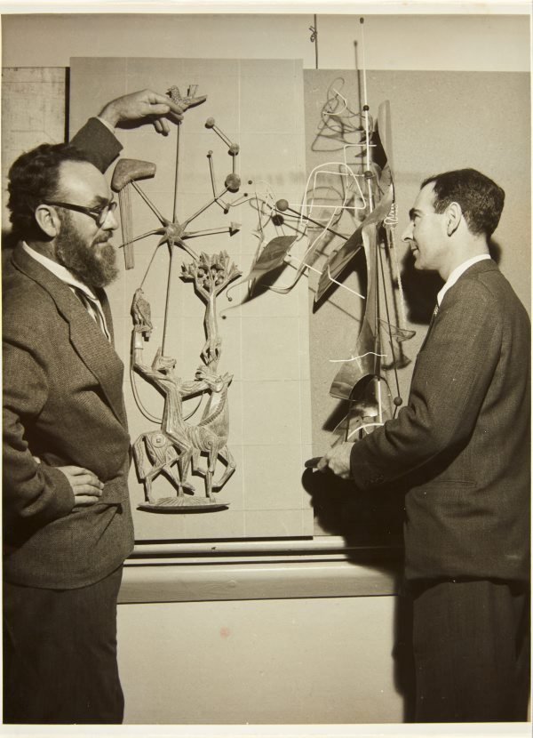 An image of Robert Klippel and Tom Bass with their works at the third exhibition of the Society of Sculptors and Associates in 1953