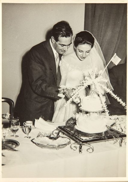An image of Robert Klippel and Nina Mermey cutting their wedding cake by Unknown photographer