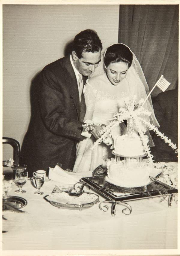 An image of Robert Klippel and Nina Mermey cutting their wedding cake