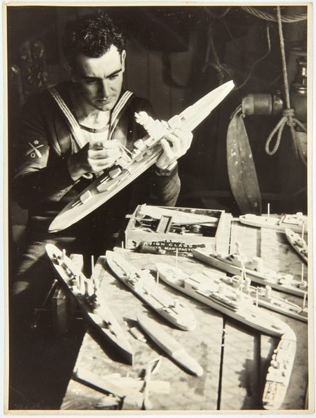 An image of Robert Klippel working on a model naval ship by Unknown