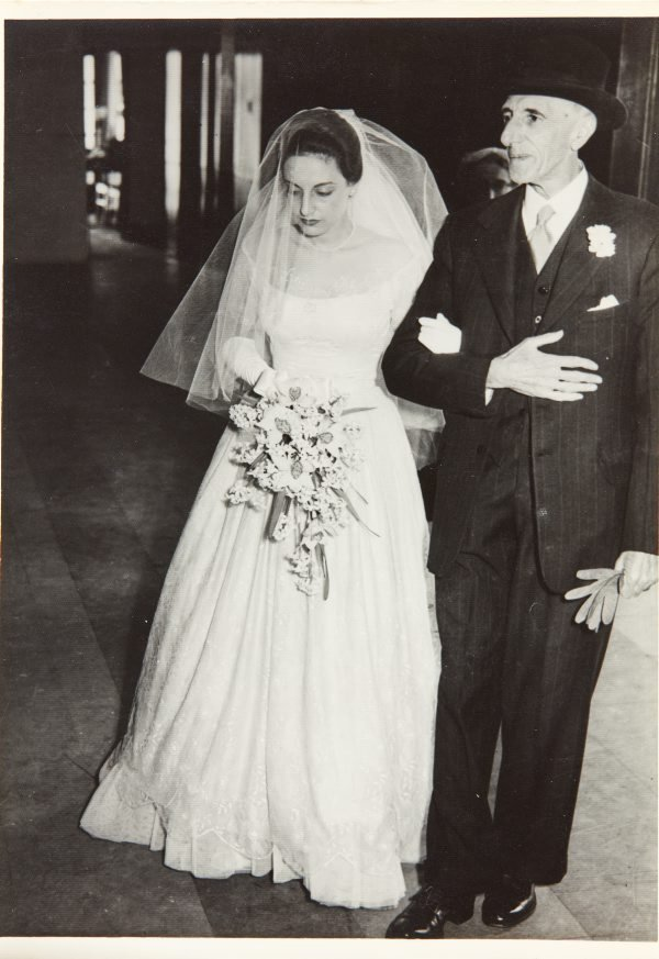 An image of Nina Mermey with her father on her wedding day