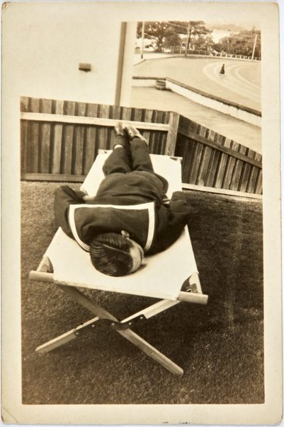 An image of Robert Klippel asleep on a cot during leave from the Navy by Unknown