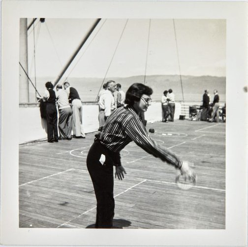 An image of Nina Mermey playing deck games aboard the Oronsay by Robert Klippel