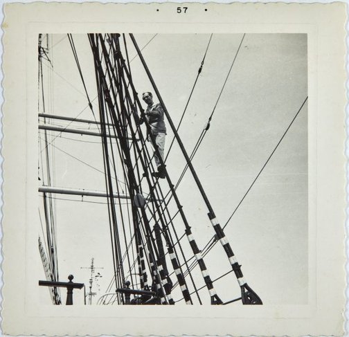 An image of Robert Klippel climbing ropes on a sail boat  in San Francisco by Unknown photographer