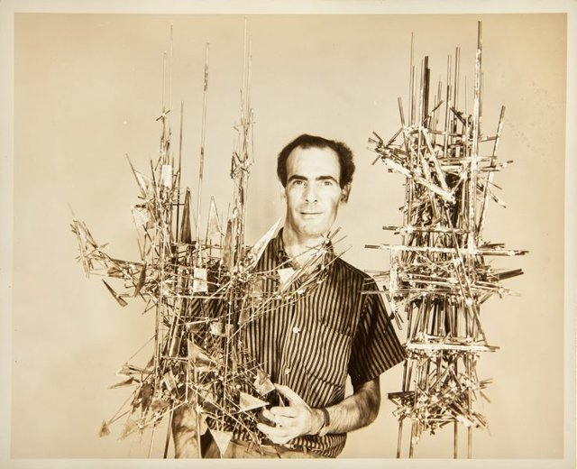 An image of Robert Klippel with metal constructions No. 73 and No. 83 in New York