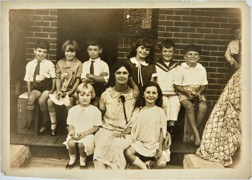An image of Miss Hall with students in her kindergarten class by Unknown