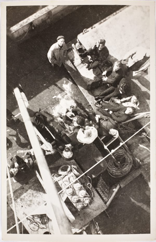 An image of Aerial view of sailors on the deck of the HMAS Bombo