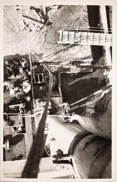 An image of Aerial view from the mast of sailors on the deck of the HMAS Bombo by Robert Klippel