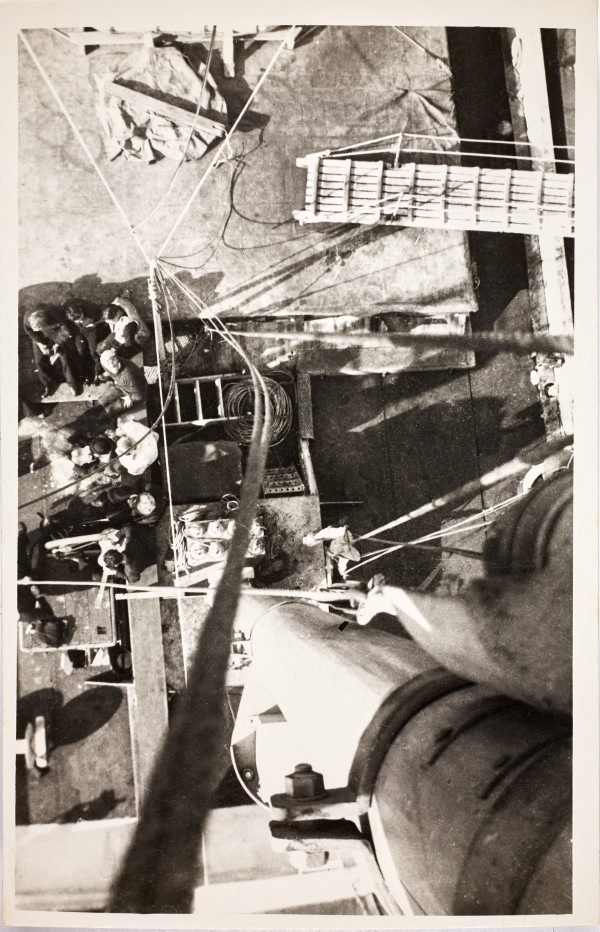 An image of Aerial view from the mast of sailors on the deck of the HMAS Bombo