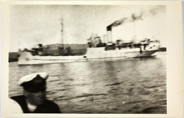 An image of View of the HMAS Bombo with the captain in the foreground
