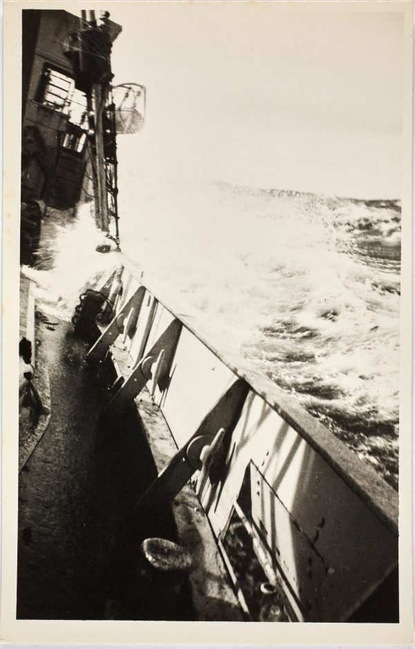 An image of Waves splashing on the deck of the HMAS Bombo