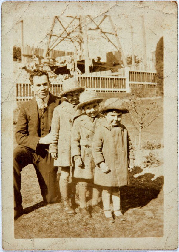 An image of David, Robert and John Klippel with their uncle Sam at Wollstonecraft