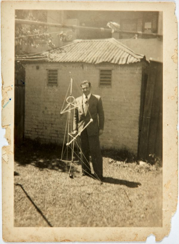 An image of Robert Klippel with one of his constructions