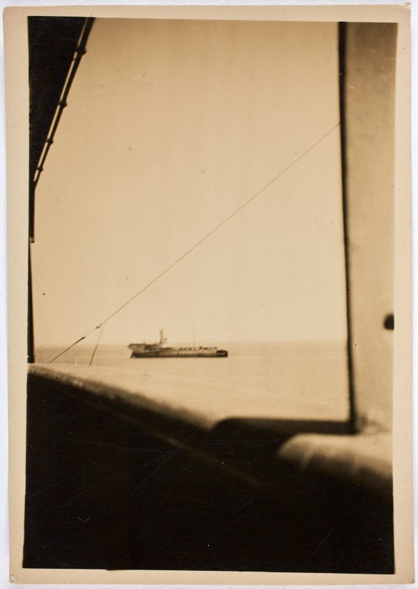 An image of A naval ship in the distance