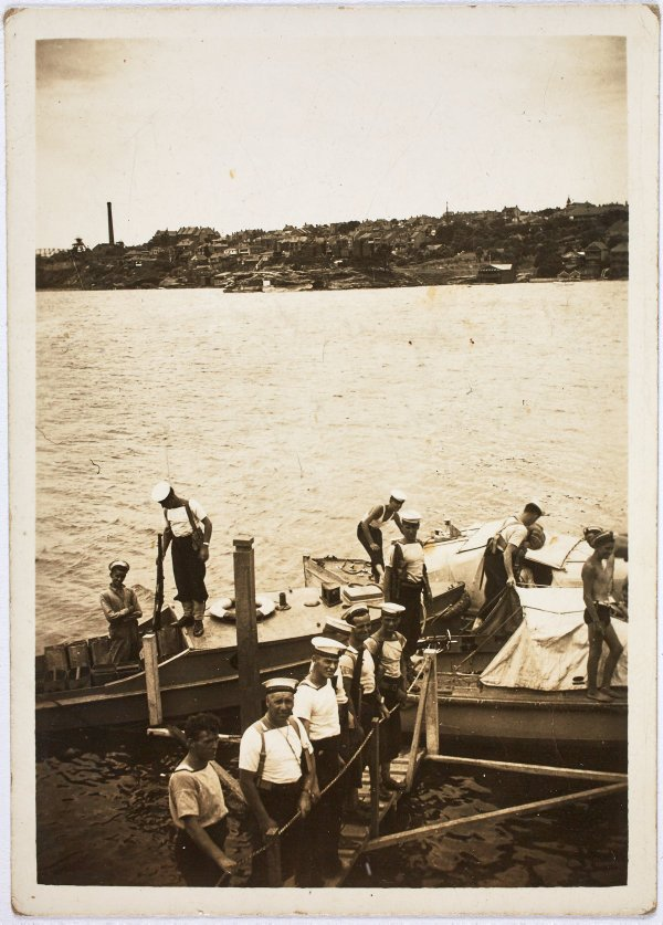 An image of Sailors on Snapper Island embarking for guard duty