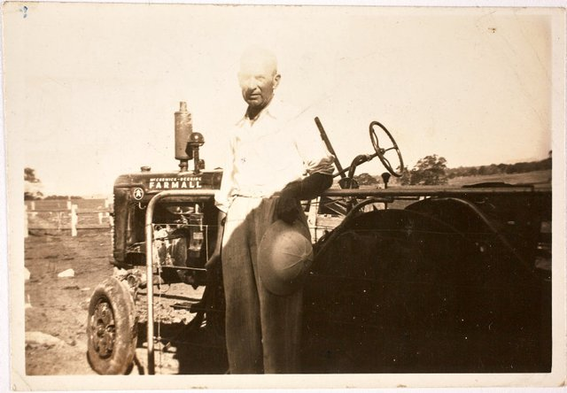 An image of Alec Klippel with his new tractor