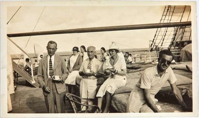 An image of Robert Klippel's mother and father with Mr. Susman having afternoon tea on an RMS Oronsay cruise