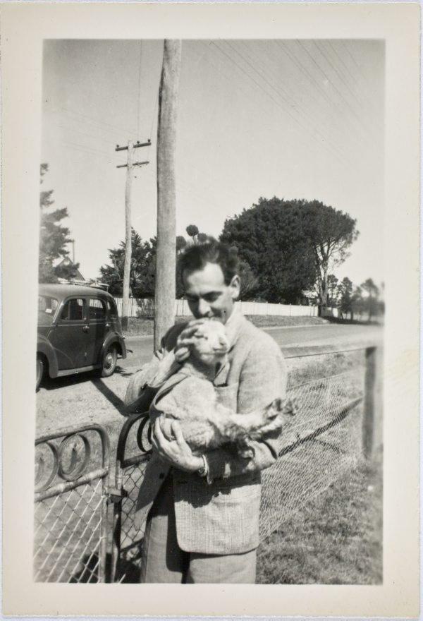An image of Robert Klippel holding a lamb
