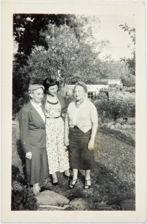 An image of Robert Klippel's mother, Haide, and his wife Nina Mermey with family friend in the garden