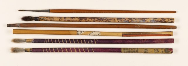 An image of Paint and ink brushes used by Rayner Hoff