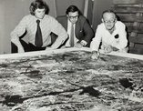 An image of James Mollison and Peter Laverty watching conservator William Boustead examining 'Blue Poles' 1952 by Jackson Pollock by Unknown