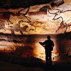Image: Palaeolithic bulls and other animals crowd calcite walls at Lascaux (detail). Photograph by Sisse Brimberg, National Geographic. Getty Images.