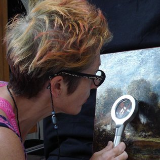 Investigating Constable with conservator Sarah Cove