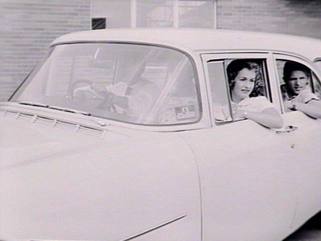 People in FB or EL Holden Car, date unknown, State Library of NSW Collection