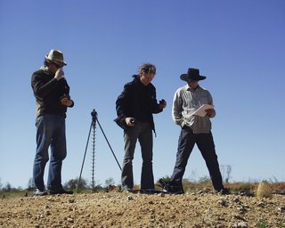 Laing and assistants in 2003 in the Tanami Desert, shooting the series *one dozen unnatural disasters in the Australian landscape*. Photo Peter Burgess.