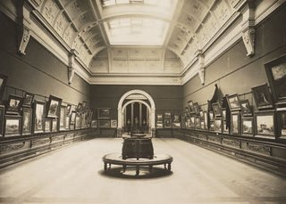 Walter Liberty Vernon's long gallery hung entirely with watercolours around the time it opened in 1901. Image from Art Gallery of NSW Archive