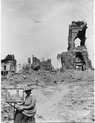 This gelatin silver photograph from the Art Gallery of NSW's National Art Archive, by an unknown photographer, shows Evelyn Chapman, the first Australian female artist to visit the battlefields, painting the ruins of the church at Villers-Bretonneux, France, c1919.