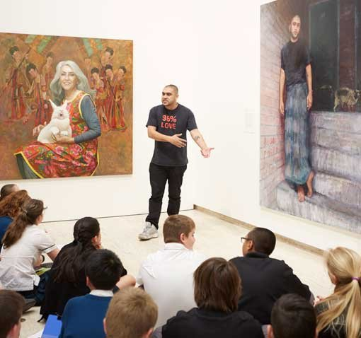 Omar Musa, poet, rapper and 2015 Archibald Prize finalist, performs for Turramurra High School students in the exhibition space at the Art Gallery of NSW